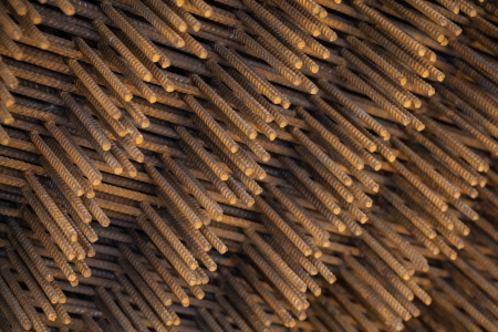 corode: Stack of rusted steel fittings construction elements Stock Photo