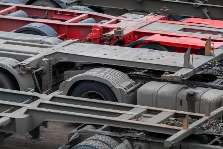 Industrial automotive transportation photo background with empty trucks cargo trailers photo