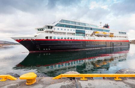 enters: Big modern Norwegian passenger cruise ship enters the port Stock Photo