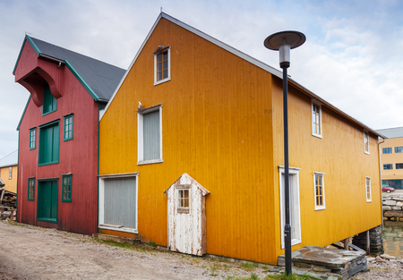 Small town street with red and yellow wooden houses in Norway photo