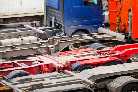 Abstract automotive transportation background with empty trucks cargo trailers photo