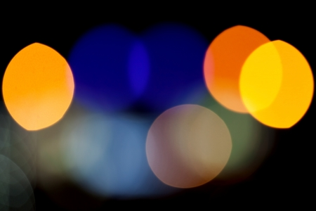 Abstract photo background with colorful lights bokeh pattern on black photo