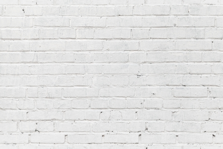 White brick wall. Seamless photo background texture Banco de Imagens