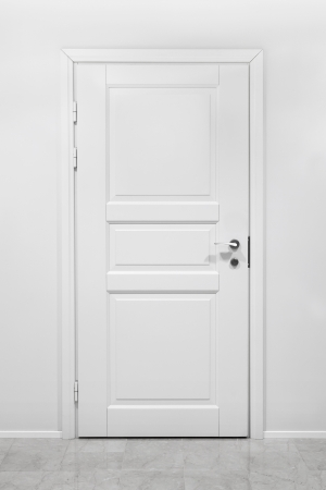hotel room door: Classical closed wooden door in white office wall