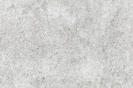 Light gray rough concrete wall. Seamless background photo texture