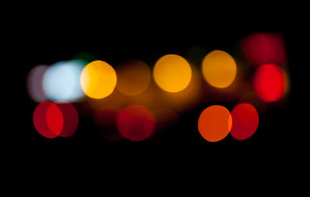 Abstract photo with colorful lights bokeh pattern on black background Stock Photo - 23419438