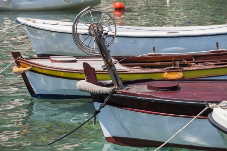 Colorful wooden fishing boats stay moored in Petrovac town, Montenegro photo