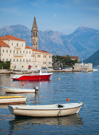 Landscape with boats. Old Perast town, Kotor bay, Montenegro photo
