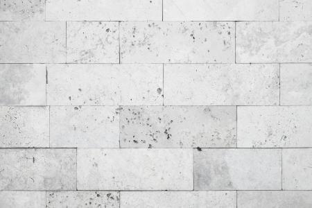 Grijze stenen muur close-up achtergrond fototextuur