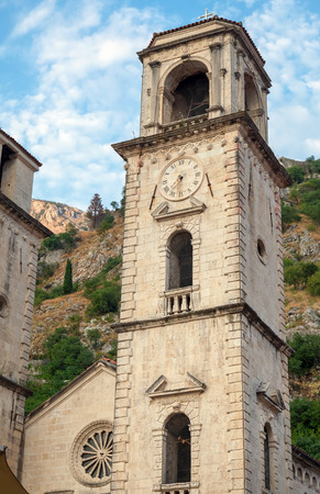 Tower with clock. Cathedral of St Tryphon, Kotor, Montenegro photo