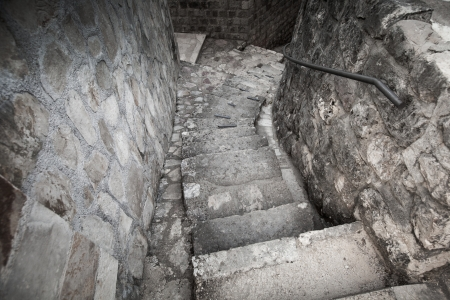 Old stone stairway on the street of Perast town, Montenegro photo