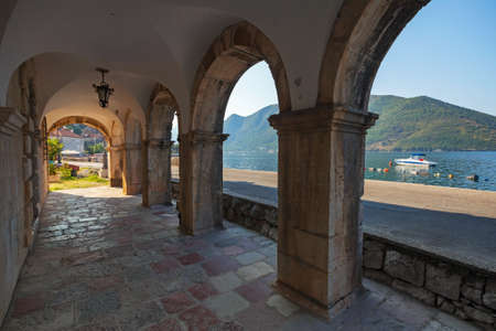 Dark archway in the old house in Perast town, Montenegro photo