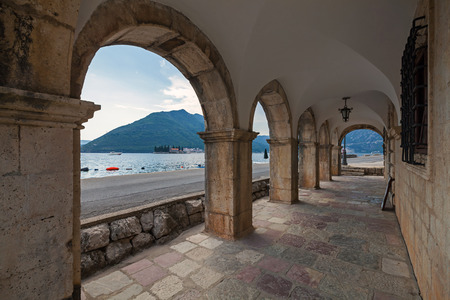 Archway in the old house in Perast town, Montenegro photo