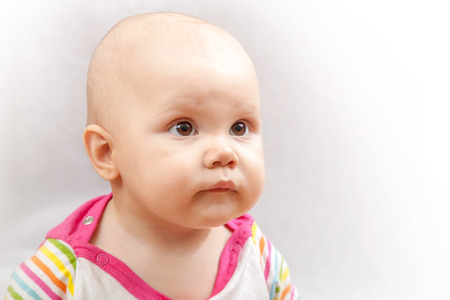brown  eyed: Little brown eyed Caucasian baby studio portrait on gray background
