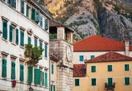 Kotor town street fragment with old clock tower , Montenegro photo