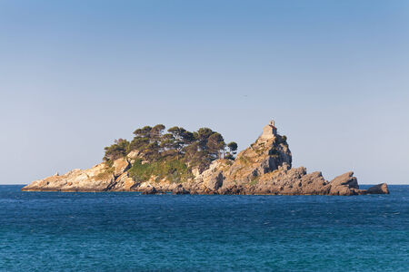 islands Katic and Sveta Nedjelja in bay of Petrovac town, Adriatic Sea, Montenegro photo