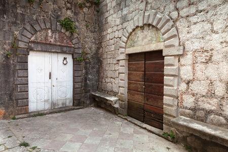 Wooden doors on the street of ancient Perast town, Kotor bay, Montenegro photo