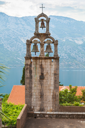 Bell tower of Orthodox Monastery Banja. Risan, Montenegro. Founded in the 12th century, reconstruction in the early 18th century photo