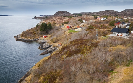 Traditional coastal Norwegian village with colorful wooden houses photo
