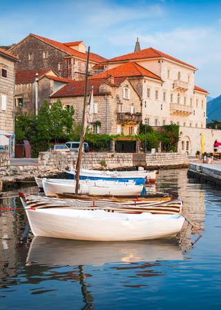 Wooden boats float moored in Perast. Kotor Bay, Montenegro photo