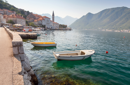 Bay of Kotor landscape with small boats. Old Perast town, Montenegro photo