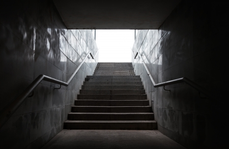 underground passage: Underground passage with stairs in the glowing end Stock Photo