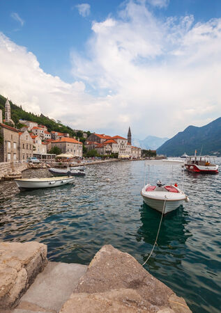 Bay of Kotor, Montenegro. Small boats moored in Perast town photo