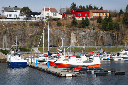 Fishing and pleasure boats stand moored in Norway village photo