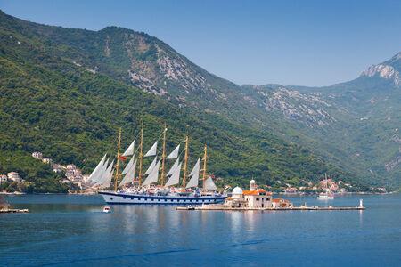 Bay of Kotor. Small island and big sailing ship photo