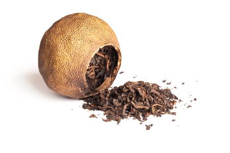 pu: Chinese dark tea Pu-erh packed in dried mandarin isolated on white Stock Photo