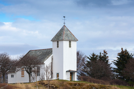 Traditional white wooden Norwegian Lutheran Church in small town photo