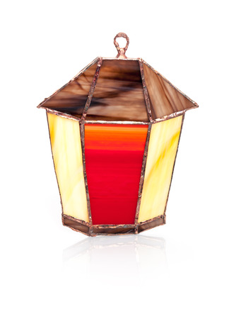 Handmade stained glass lantern isolated on white photo