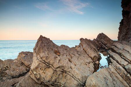 Coastal rocks and sky on Adriatic seacoast. Montenegro
