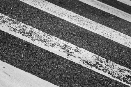 Pedestrian crossing road marking on dark asphalt photo