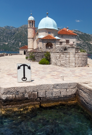 Ancient church on small island in Bay of Kotor, Montenegro photo