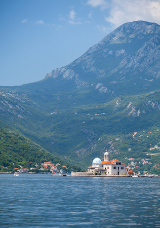 Bay of Kotor, Montenegro  Mountains and small island with old church photo