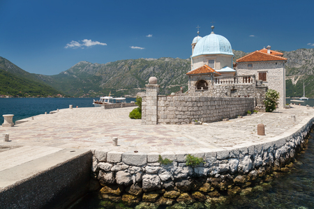 Old church on small island in Bay of Kotor, Montenegro photo