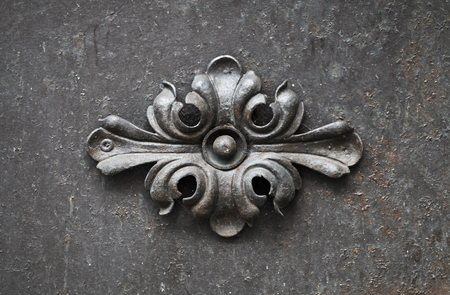 ancient blacksmith: Ancient forged floral decoration element on black door