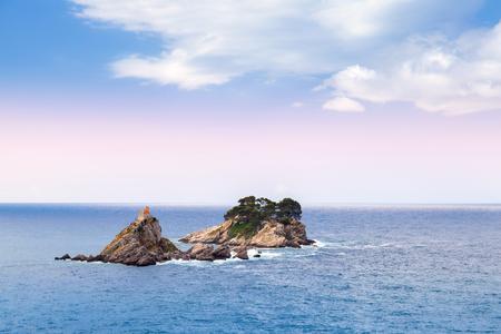Small islands in Adriatic Sea. Petrovac bay, Montenegro photo