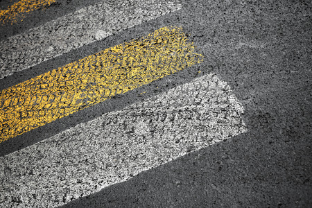 Pedestrian crossing road marking on dirty asphalt pavement photo