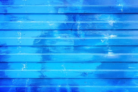 Ridged blue painted metal wall background texture photo