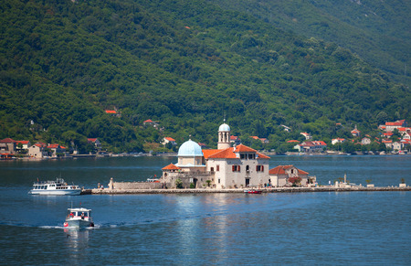 Our Lady of the Rocks. Island with small Church in Kotor Bay photo