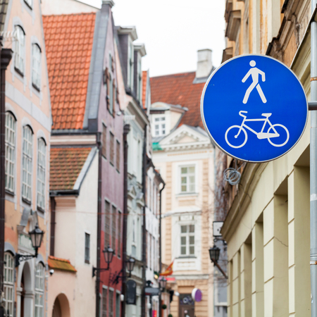 Blue pedestrian zone road sign in old city center. Riga, Latvia photo