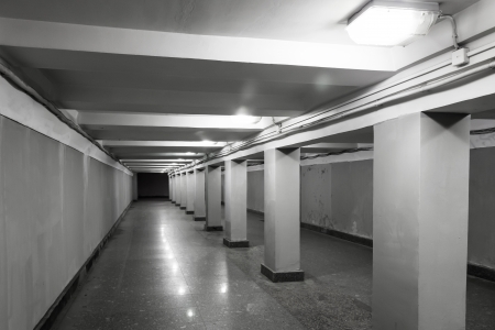underground passage: Underground passage interior with lights and concrete columns  Stock Photo