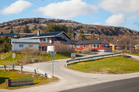 Norwegian village with colorful wooden houses on rocky hill photo