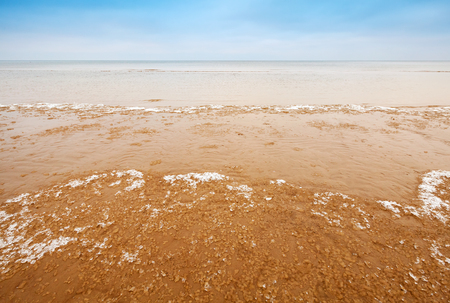 jurmala: Fragments of ice on empty sandy coast of Baltic Sea
