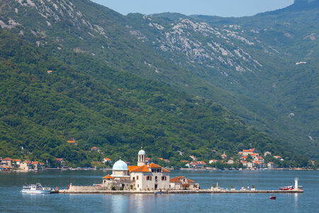 Church on island Our Lady of the Rocks in Bay of Kotor photo