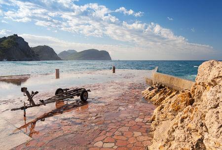 boat trailer: Stone breakwater and old boat trailer, Montenegro