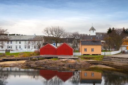 Colorful wooden houses in small Norwegian fishing village photo