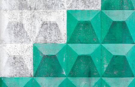 White and green pattern on concrete fence. Background texture photo